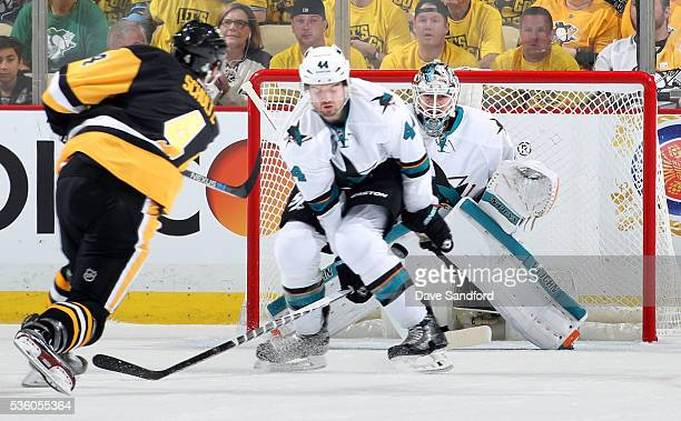 Goaltender Martin Jones of the San Jose Sharks gets in position to face the shot as defenseman MarcEdouard Vlasic of the San Jose Sharks tries to...