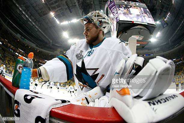 Goaltender Martin Jones of the San Jose Sharks grabs a water bottle at the bench during warmup prior to Game Two of the 2016 NHL Stanley Cup Final...