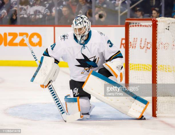 Goaltender Martin Jones of the San Jose Sharks guards the net during first period action against the Winnipeg Jets at the Bell MTS Place on February...
