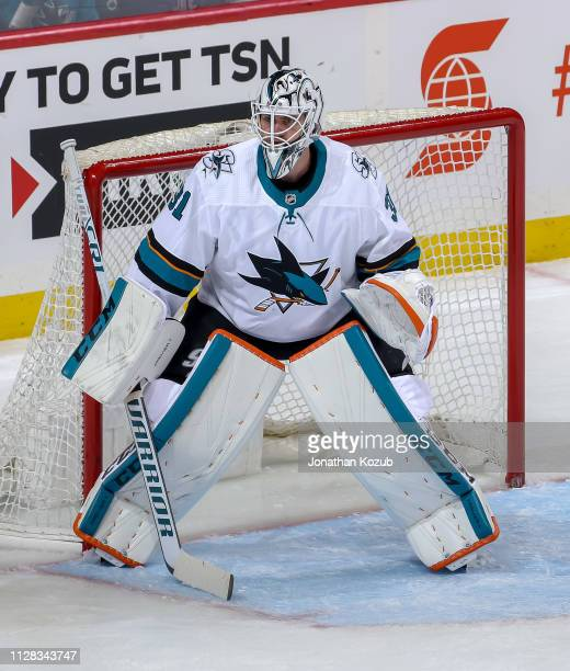 Goaltender Martin Jones of the San Jose Sharks guards the net during second period action against the Winnipeg Jets at the Bell MTS Place on February...