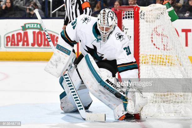 Goaltender Martin Jones of the San Jose Sharks makes a glove save during the third period of a game against the Columbus Blue Jackets on February 2...