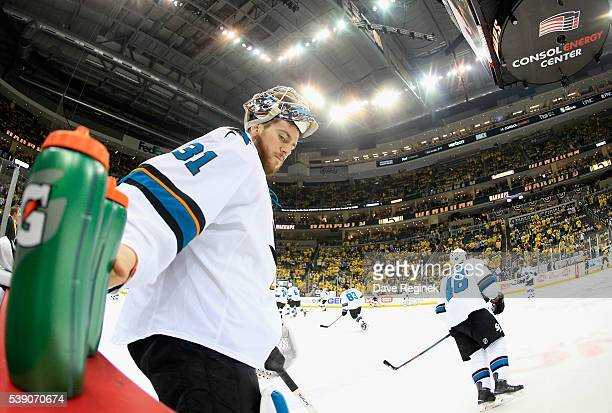 Goaltender Martin Jones of the San Jose Sharks reaches for a drink during warm ups before playing in Game 5 of the 2016 NHL Stanley Cup Final against...