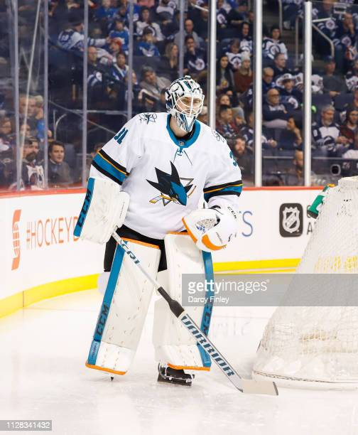 Goaltender Martin Jones of the San Jose Sharks skates around the net during second period action against the Winnipeg Jets at the Bell MTS Place on...