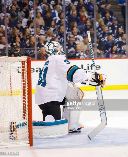 Goaltender Martin Jones of the San Jose Sharks takes a knee in the crease during a second period stoppage in play against the Winnipeg Jets at the...
