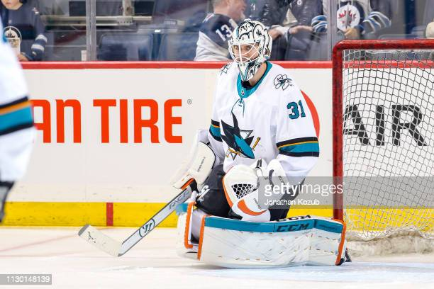 Goaltender Martin Jones of the San Jose Sharks takes part in the pregame warm up prior to NHL action against the Winnipeg Jets at the Bell MTS Place...