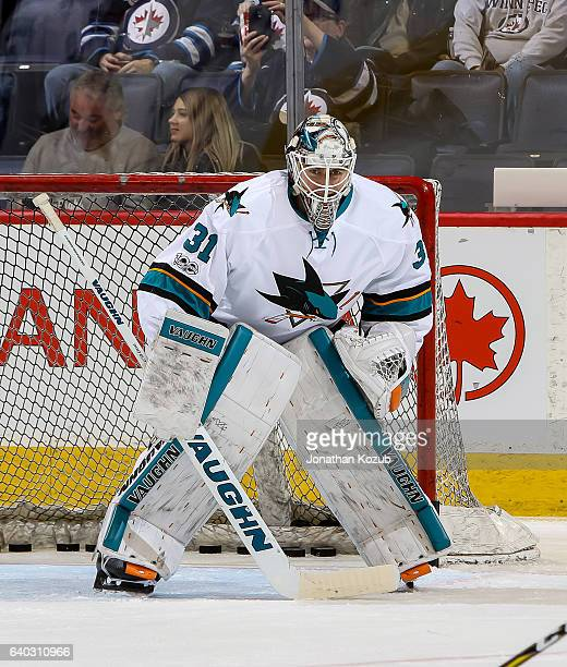 Goaltender Martin Jones of the San Jose Sharks takes part in the pregame warm up prior to NHL action against the Winnipeg Jets at the MTS Centre on...