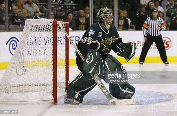 Goaltender Marty Turco of the Dallas Stars gets set for a shot on goal by the Vancouver Canucks during game three of the 2007 NHL Western Conference...