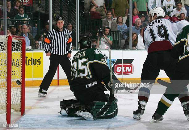 Goaltender Marty Turco of the Dallas Stars looks behind him as the game winning goal scored by Joe Sakic of the Colorado Avalanche during Game two of...