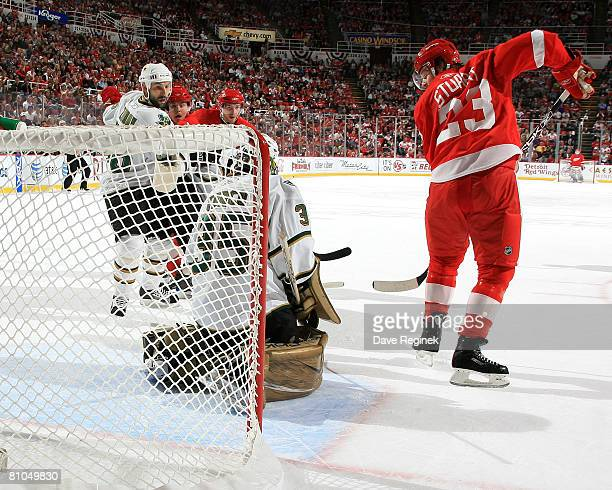 Goaltender Marty Turco of the Dallas Stars make a stop on a shot from Brad Stuart of the Detroit Red Wings during game two of the Western Conference...