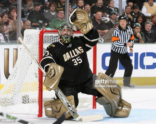 Goaltender Marty Turco of the Dallas Stars makes a glove save on a shot from the Detroit Red Wings during game four of the Western Conference Finals...