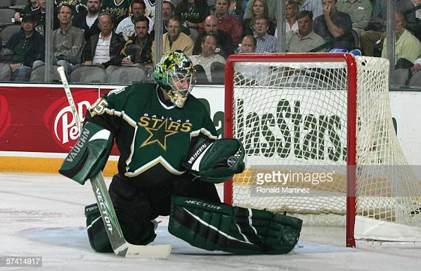 Goaltender Marty Turco of the Dallas Stars makes a save on the shot by the Colorado Avalanche during the first period of Game two of the NHL Western...
