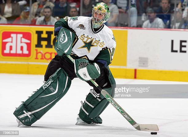Goaltender Marty Turco of the Dallas Stars skates to the middle slot to play the puck against the Vancouver Canucks during their NHL playoff game at...