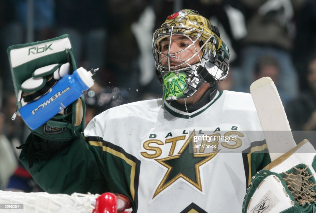 Goaltender Marty Turco #35 of the Dallas Stars takes a drink during the NHL game against the Vancouver Canucks at General Motors Place on October 16, 2005 in Vancouver, Canada. The Canucks defeated the Stars 5-2.