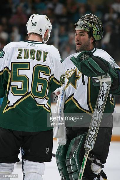 Goaltender Marty Turco of the Dallas Stars talks with Sergi Zubov during a game against the San Jose Sharks on February 10 2006 at the HP Pavilion in...
