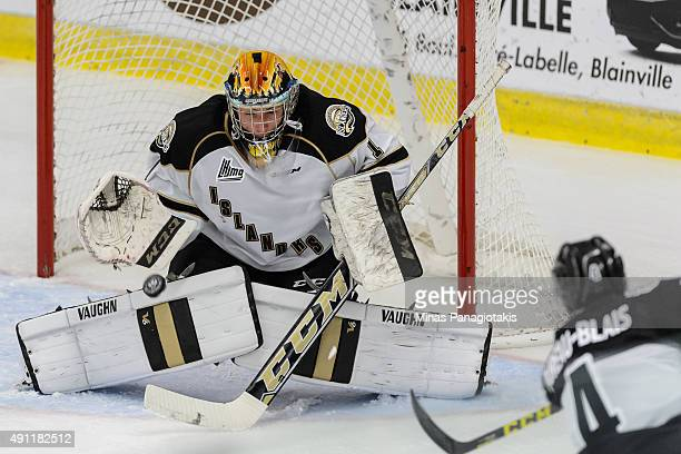 Goaltender Mason McDonald of the Charlottetown Islanders extends the glove to make a save during the QMJHL game against the BlainvilleBoisbriand...