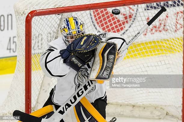 Goaltender Mathieu Bellemare of the Gatineau Olympiques makes a save during the QMJHL game against the BlainvilleBoisbriand Armada at the Centre...