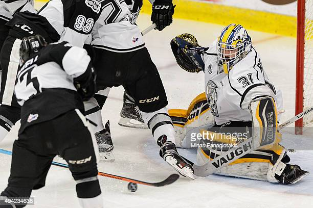 Goaltender Mathieu Bellemare of the Gatineau Olympiques watches the puck on a shot by Connor Bramwell of the BlainvilleBoisbriand Armada during the...