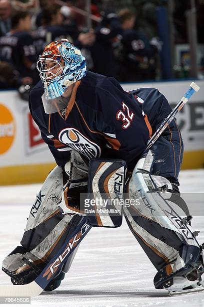 Goaltender Mathieu Garon of the Edmonton Oilers skates to his net during a break in action against the Calgary Flames during their NHL game at Rexall...