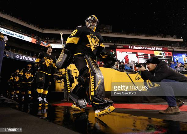 Goaltender Matt Murray of the Pittsburgh Penguins and his teammates make their way to the ice surface for warmup prior to the 2019 Coors Light NHL...