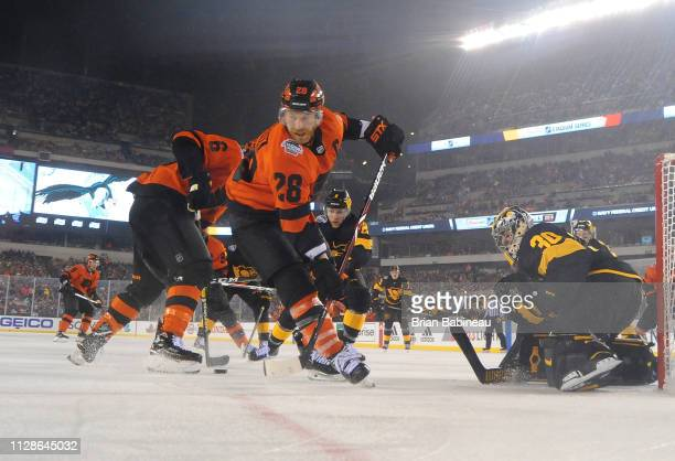 Goaltender Matt Murray of the Pittsburgh Penguins defends his net as Claude Giroux of the Philadelphia Flyers turns away from the play during the...