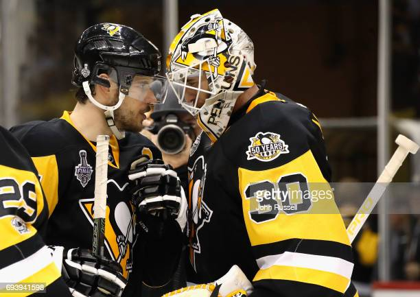 Goaltender Matt Murray of the Pittsburgh Penguins is congratulated by teammate Sidney Crosby after their 6-0 victory over the Nashville Predators in...