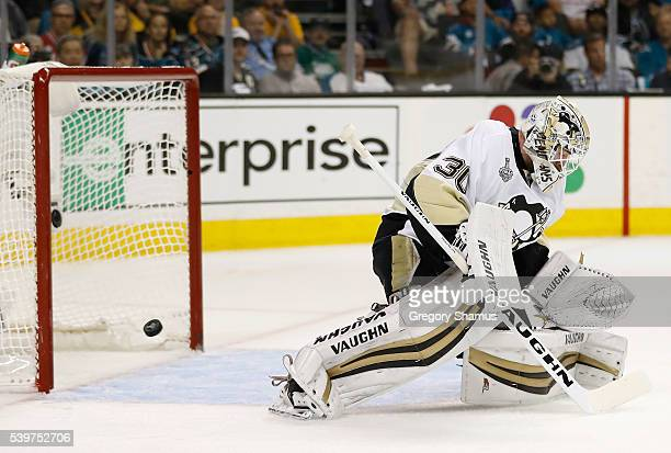 Goaltender Matt Murray of the Pittsburgh Penguins lets the puck through on a shot by Logan Couture of the San Jose Sharks to score in the second...