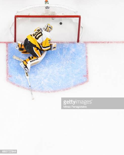 Goaltender Matt Murray of the Pittsburgh Penguins looks at the puck in his net after allowing a goal in the second period against the Ottawa Senators...