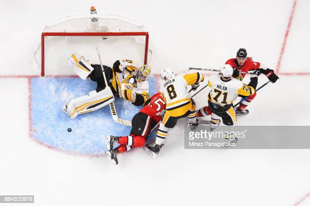 Goaltender Matt Murray of the Pittsburgh Penguins loses sight of the puck against the Ottawa Senators as players scramble in front of him in Game...