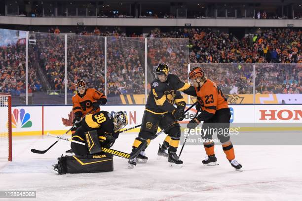 Goaltender Matt Murray of the Pittsburgh Penguins makes a save as Oskar Lindblom of the Philadelphia Flyers looks for the loose puck during the 2019...
