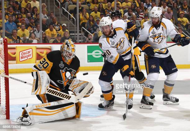 Goaltender Matt Murray of the Pittsburgh Penguins makes a save as Colton Sissons and James Neal of the Nashville Predators look on during the third...