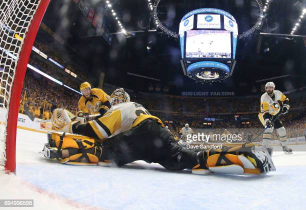 Goaltender Matt Murray of the Pittsburgh Penguins makes a save on a shot attempt by Colton Sissons of the Nashville Predators in the second period of...