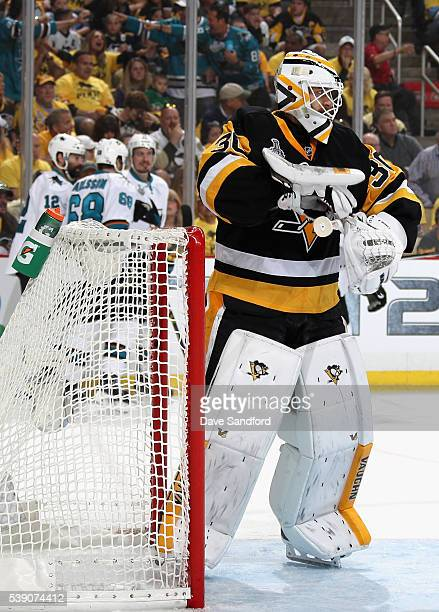Goaltender Matt Murray of the Pittsburgh Penguins reacts after a goal by Brent Burns of the San Jose Sharks during the first period of Game 5 of the...