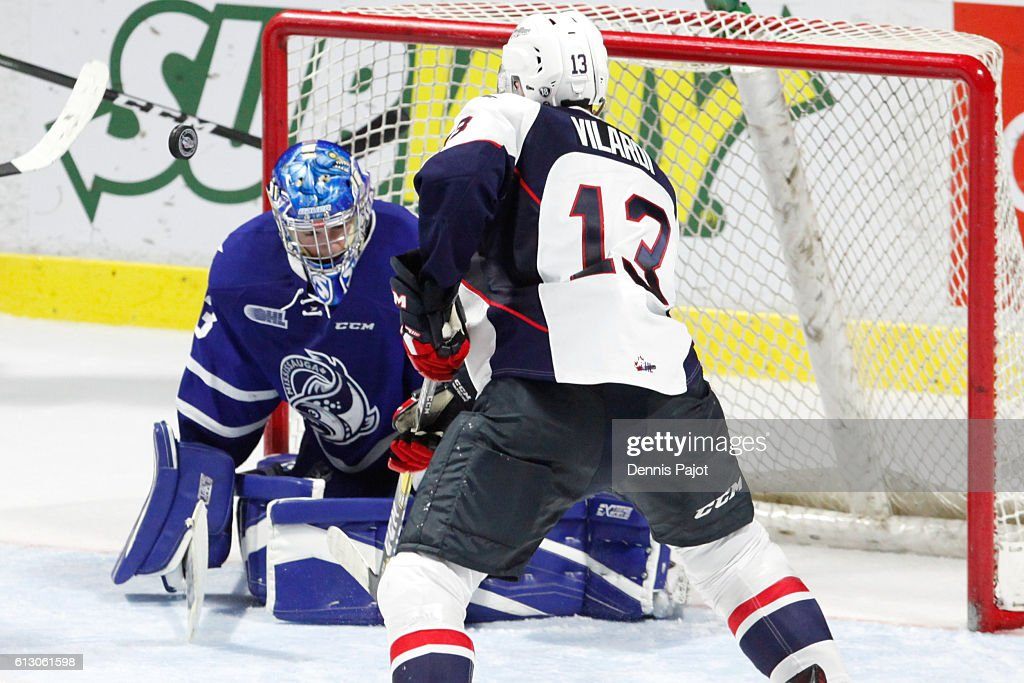 Goaltender Matthew Mancina #33 of the Mississauga Steelheads makes a huge save on a shot from forward Gabriel Vilardi #13 of the Windsor Spitfires on October 6, 2016 at the WFCU Centre in Windsor, Ontario, Canada.