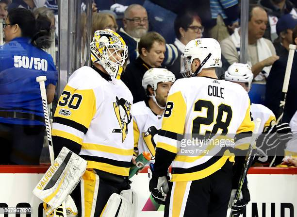 Goaltender Matthew Murray and Ian Cole of the Pittsburgh Penguins discuss strategy during a first period stoppage in play against the Winnipeg Jets...