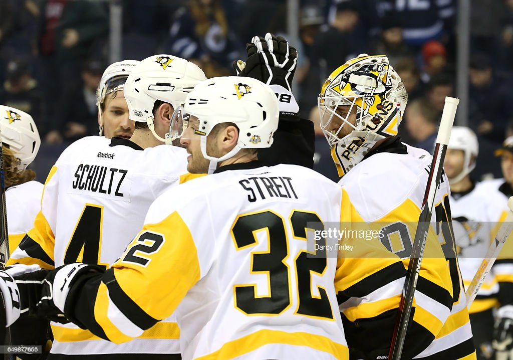 Goaltender Matthew Murray #30 of the Pittsburgh Penguins gets congratulated by teammates following 7-4 victory over the Winnipeg Jets at the MTS Centre on March 8, 2017 in Winnipeg, Manitoba, Canada.