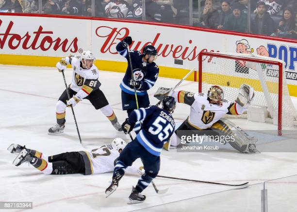 Goaltender Maxime Lagace of the Vegas Golden Knights deflects a shot by Mark Scheifele of the Winnipeg Jets over the crossbar during second period...