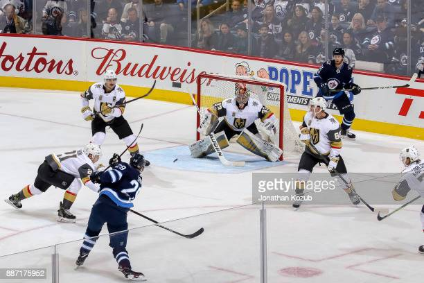 Goaltender Maxime Lagace of the Vegas Golden Knights guards the net as Patrik Laine of the Winnipeg Jets takes a shot on goal during second period...