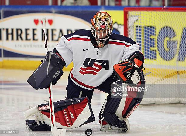 Goaltender Megan Van Beusekom of Team USA plays the puck out of the crease after makeing a save against team Germany in a IIHF World Women's...