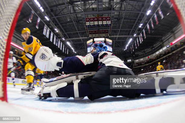 Goaltender Michael DiPietro of the Windsor Spitfires defends makes a glove save against forward Anthony Cirelli of the Erie Otters on May 24 2017...