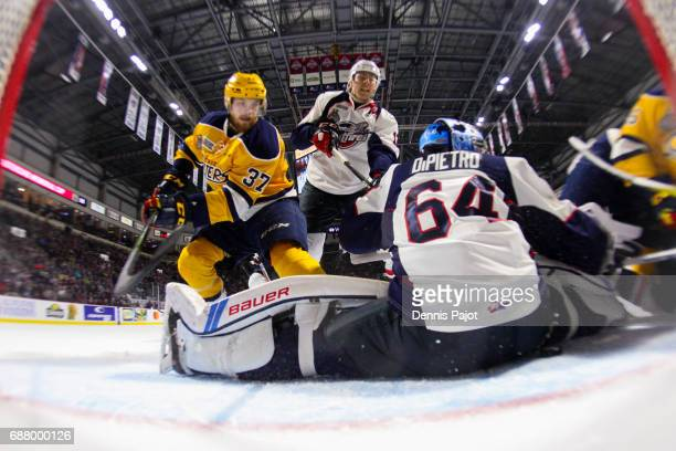 Goaltender Michael DiPietro of the Windsor Spitfires defends the net on a rebound against the Erie Otters on May 24 2017 during Game 6 of the...