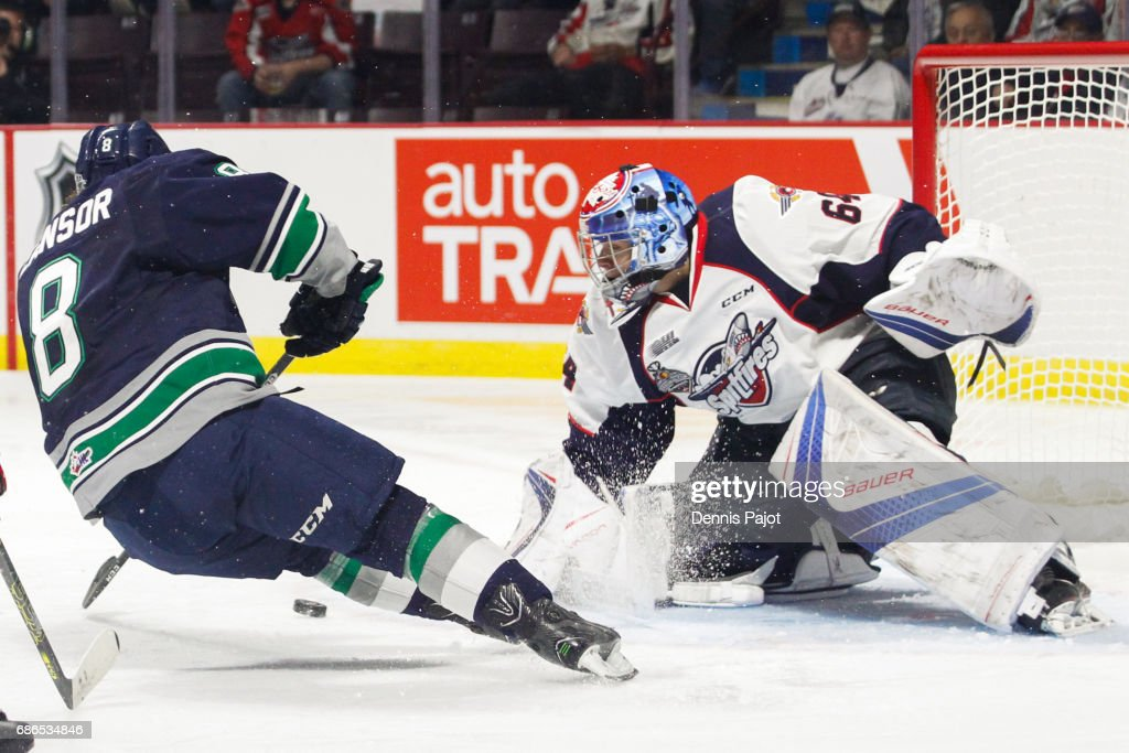 Goaltender Michael DiPietro #64 of the Windsor Spitfires makes a save on a breakaway from forward Scott Eansor #8 of the Seattle Thunderbirds on May 21, 2017 during Game 3 of the Mastercard Memorial Cup at the WFCU Centre in Windsor, Ontario, Canada.