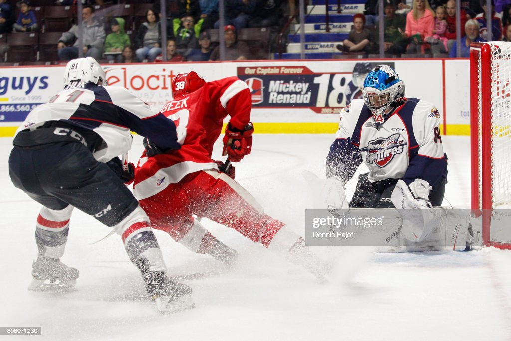 Goaltender Michael DiPietro #64 of the Windsor Spitfires makes a stick save against forward Hayden Verbeek #38 of the Sault Ste. Marie Greyhounds on October 5, 2017 at the WFCU Centre in Windsor, Ontario, Canada.