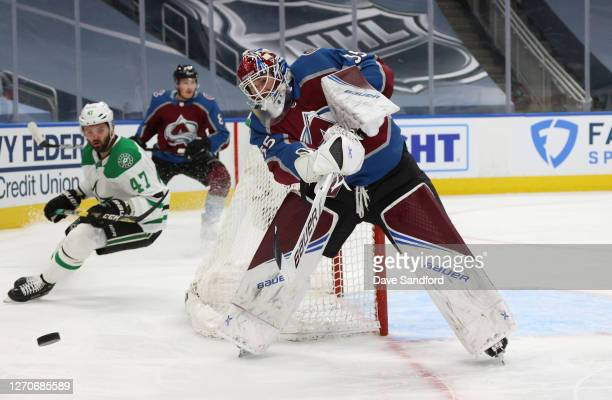 Goaltender Michael Hutchinson of the Colorado Avalanche plays the puck into the corner in the first period of Game Seven of the Western Conference...