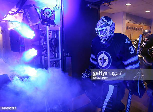 Goaltender Michael Hutchinson of the Winnipeg Jets heads to the ice prior to puck drop against the Buffalo Sabres at the MTS Centre on October 30...