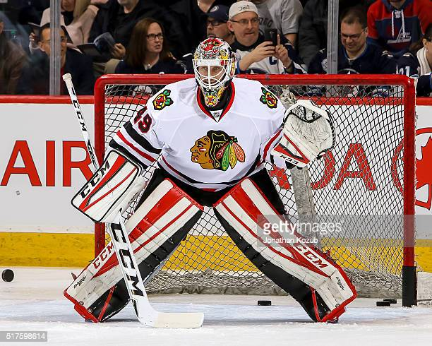 Goaltender Michael Leighton of the Chicago Blackhawks takes part in the pregame warm up prior to NHL action against the Winnipeg Jets at the MTS...