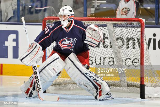 Goaltender Michael Leighton of the Columbus Blue Jackets warms up before a game against the San Jose Sharks on April 9 2013 at Nationwide Arena in...