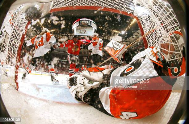 Goaltender Michael Leighton of the Philadelphia Flyers leans back to cover the puck in the net during the first period of Game Two of the 2010 NHL...
