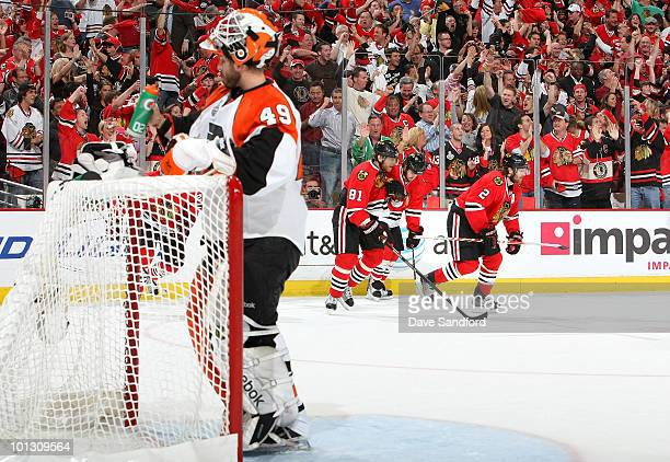 Goaltender Michael Leighton of the Philadelphia Flyers takes a drink as the Chicago Blackhawks celebrate a goal by Marian Hossa during the second...