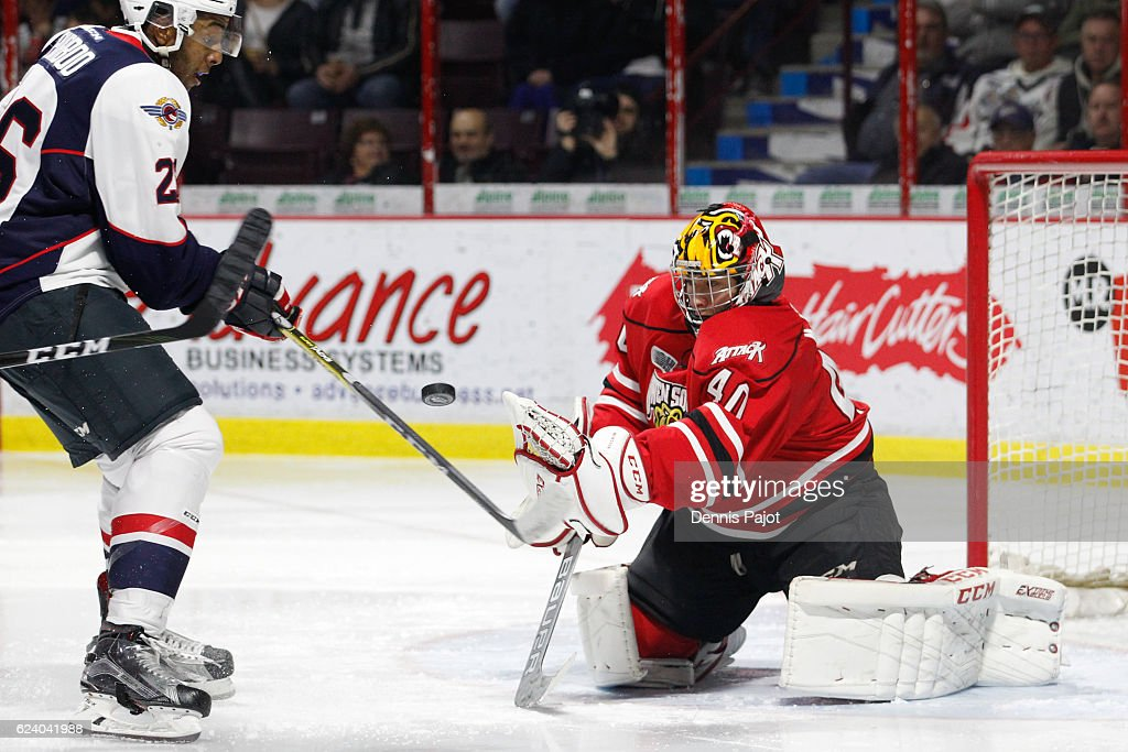 Goaltender Michael McNiven #40 of the Owen Sound Attack makes a huge save on a shot from Cole Purboo #26 of the Windsor Spitfires on November 17, 2016 at the WFCU Centre in Windsor, Ontario, Canada.