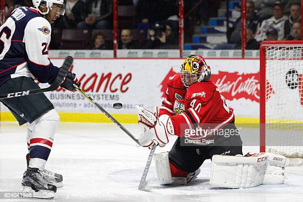 Goaltender Michael McNiven of the Owen Sound Attack makes a huge save on a shot from Cole Purboo of the Windsor Spitfires on November 17 2016 at the...